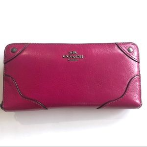 | Coach | pink leather wallet
